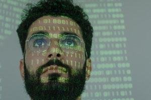 binary computer patterns across man's face